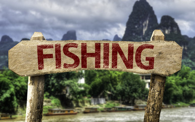 Fishing sign with a forest background