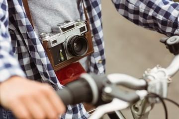 Close up of the bike and a retro camera