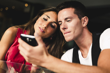 Couple using mobile phone