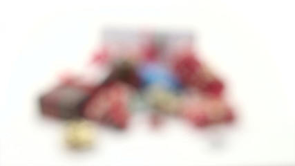 Christmas gifts isolated on white background, blurred end