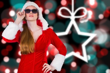 Composite image of cool santa girl wearing sunglasses