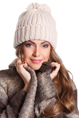 Closeup of a beautiful woman in cap on white background