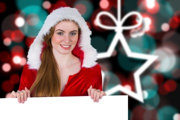 Composite image of pretty girl in santa costume showing card