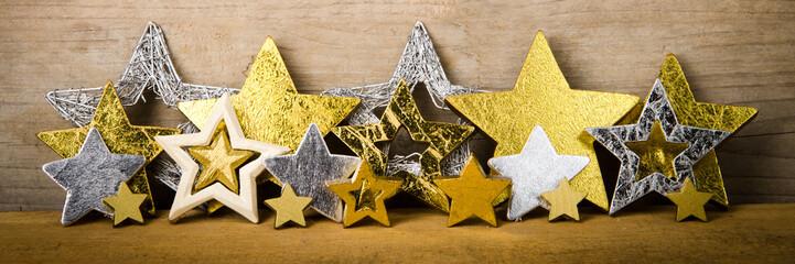 goldene und silberne weihnachtssterne als banner