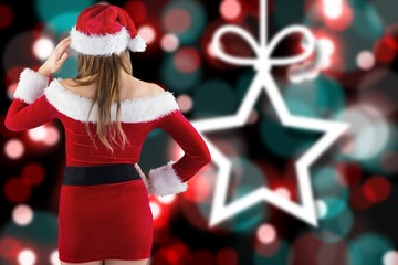 Composite image of sexy santa girl with hand on hip
