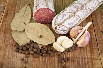 salame, garlic and laurel leaves