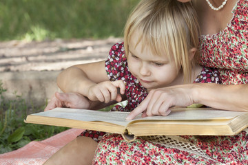 Girl sees something in books featuring mom