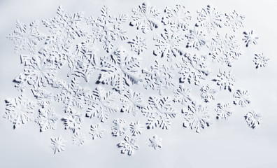 Paper snowflakes on white background