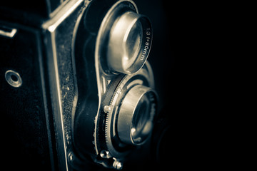 Vintage twin reflex camera isolated on black