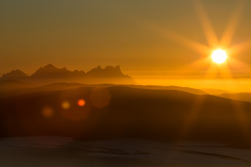 Sunset, with mountain scenery and lens reflex