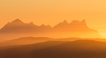 mountains with sun and haze