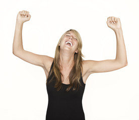 Woman cheering with arms in the air