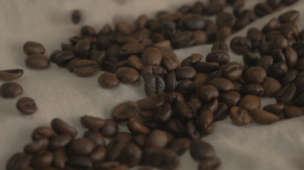 Roasted coffee beans. Falling coffee beans