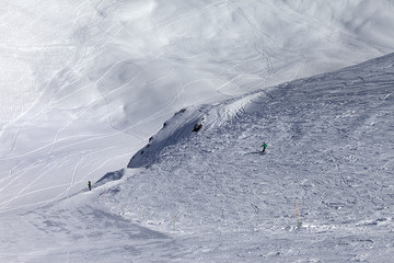 Skiers on off-piste slope in nice sun day