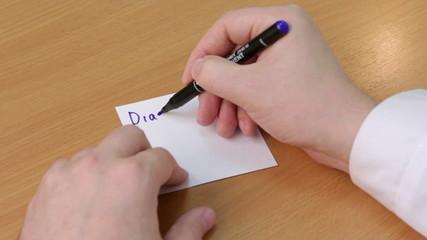 Doctor writes diagnosis closeup