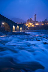 The old town of Bobbio and the bridge Gobbo by night, Italy