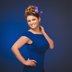 Photo of a young woman with flowers. Plus size model.