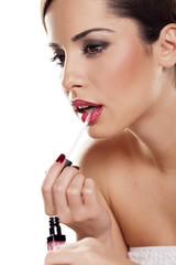 young beautiful woman applied lip gloss