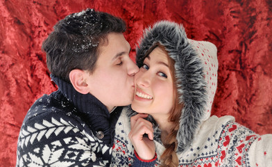 happy kissing couple having fun in christmas time