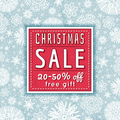 blue christmas background and  label with sale offer