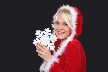 Attraktive Weihnachtsfrau mit Schneekristall