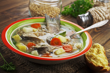 Homemade soup of river fish in the bowl