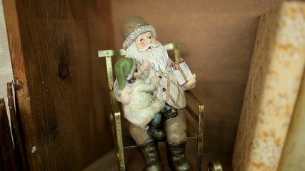 Toy Santa in a rocking chair on the shelf