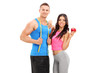 Active young couple posing with an apple