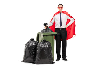 Superhero standing by a trash can