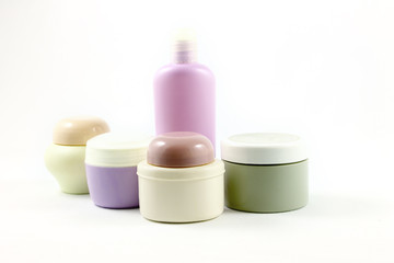 Containers of beauty products without labels