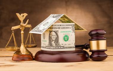judge gavel with money house closeup