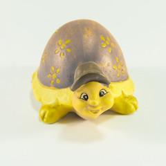 Decorative yellow tortoise ceramic with brown hat