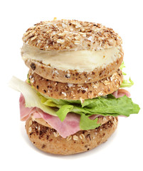 brown bagels filled with spreadable cheese and ham and lettuce m