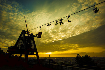 Prague Metronome, Shoes on a wire at romantic sunrise