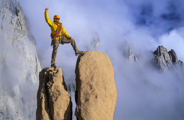 Man on a mountain peak.
