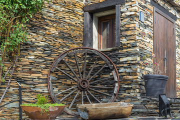 wheel resting on the stone wall