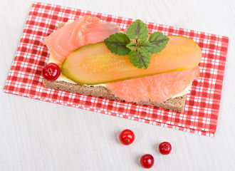 rye bread with butter, salmon and pickled cucumber