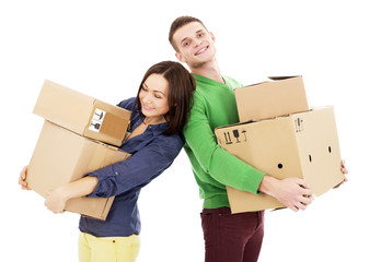 Young Couple With Moving Boxes - Isolated - Stock Image