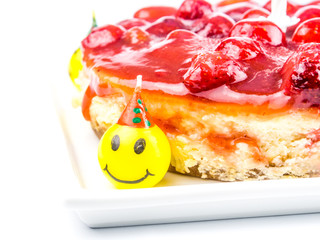 cheese cake with strawberry and funny laughing candles