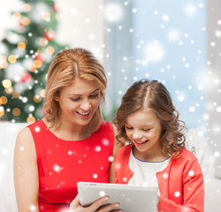 mother and daughter with tablet pc at home