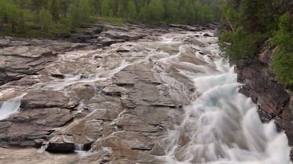 The river flows through the stone plateau