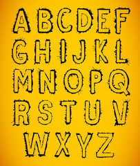 Vector alphabet letters made of watercolor or ink splashes