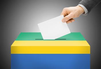 Ballot box painted into national flag colors - Gabon
