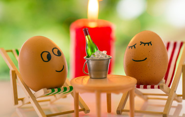funny eggs on a beach chair relaxing