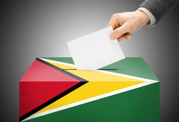 Ballot box painted into national flag colors - Guyana