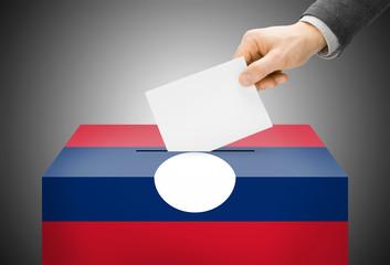 Ballot box painted into national flag colors - Laos