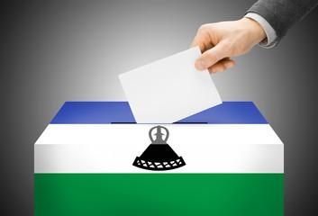 Ballot box painted into national flag colors - Lesotho