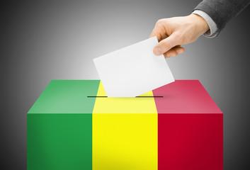 Ballot box painted into national flag colors - Mali