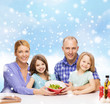 happy family with two kids showing salad in bowl