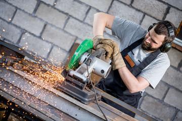 Industrial worker cutting metal